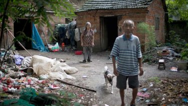 Hou Guiying, 71, and her husband, Ma Jinling, 81, outside their home in the village of Luzhai.