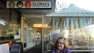 Alfresco ... Gloria Belinha sits at a table outside her Portuguese cafe in Petersham that she can now provide without paying a fee to Marrickville Council.