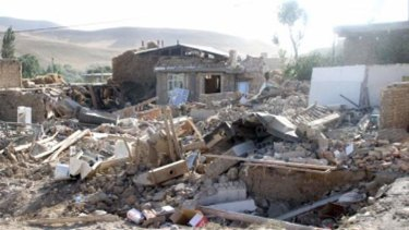 Destruction: Houses reduced to rubble in the town of Bushehr, which is home to Iran's only nuclear reactor, after the earthquake that killed 37 people and injured hundreds.
