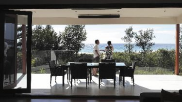 All at sea ... Ian and Sharon Cowley in their Mollymook home. Shoalhaven Council says hundreds of homes inside the predicted 2025 sea level line will be defined as ''high risk''.