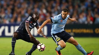 Finalising terms: Bobo, right, in action for the Sky Blues against Victory's Jason Geria in the A-League grand final.