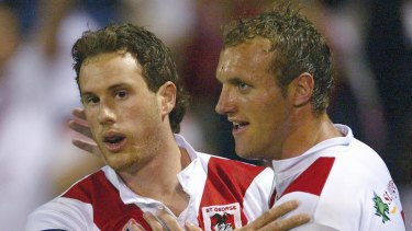 Job done: Colin Best and Mark Gasnier celebrate after the 2005 finals win over the Sharks.