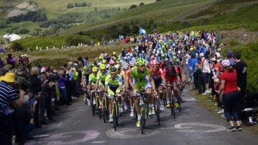 Big crowds: Many fans flocked to see the opening day of the Tour de France from Leeds to Harrogate in northern England.