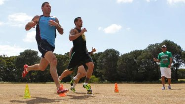 No letting up: Shaun Kenny-Dowall and Mitchell Pearce work out with Roger Fabri.