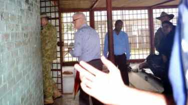 Immigration Department official tries to block Fairfax photographing Lieutenant General Angus Campbell as he visits the squalid Manus Island Police station prison where six asylum seekers were locked up for 48 hours.