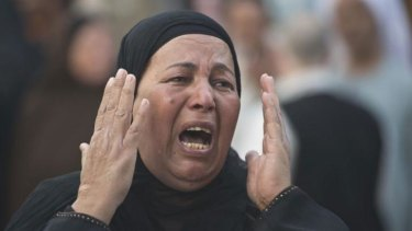 An Egyptian woman reacts outside the courtroom in Minya after Muslim Brotherhood leader Mohammed Badie and 682 other alleged Islamists were sentenced to death.