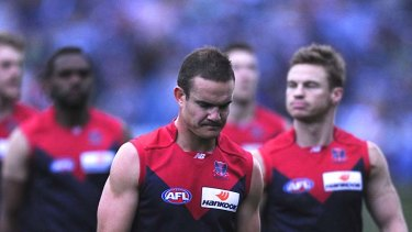 Demoralised: Skipper Brad Green and teammates leave the field after the thrashing at Geelong.
