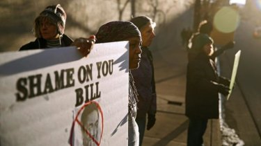 Protesters outside the Bill Cosby show at the Buell Theatre in Denver on Saturday.