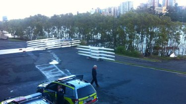Ambulance vehicles parked near the site where a rowing scull went under a CityCat, injuring a 15-year-old boy.