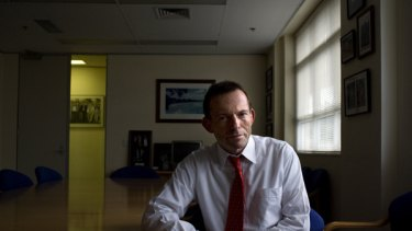 A new chapter ... Tony Abbott, in his electorate office in Manly, admits writing the book was therapeutic after the Coalition's defeat at the last election.