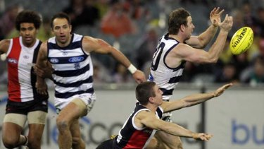 Cats forward Steve Johnson attempts to mark in front of Saints defender Steven Baker in round 13.