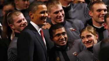 President Barack Obama poses for a picture with cadets at West Point.