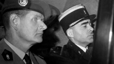 In disgrace: Helie Denoix de Saint-Marc, left, arrives at La Sante prison in Paris on June 6, 1961, to serve a 10-year sentence for his role in an attempted coup.