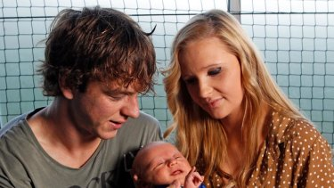 Liam Picken with his partner Annie and their four-week-old son, Malachy.