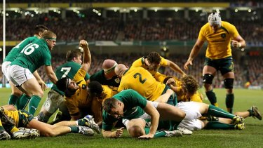 Michael Hooper of Australia scores his second try from a rolling maul.