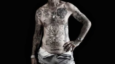 Tjepkema shows various tattoos from different stages of his life.
