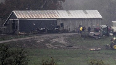 An animal carcass is dragged for burial at the Muskingum County Animal Farm.