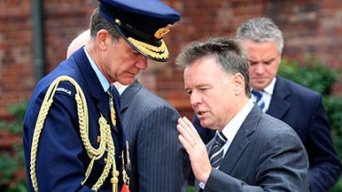 Shaken . . . the Defence Minister, Joel Fitzgibbon, with Air Chief Marshal Angus Houston yesterday.