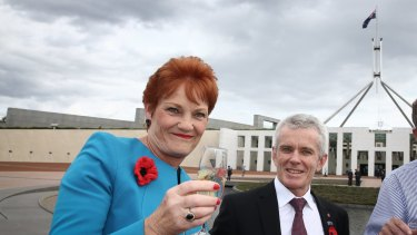 Senator Pauline Hanson with Senator Malcolm Roberts at Parliament House.