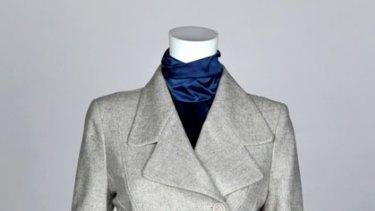 Edgy ... Arabella Ramsay jacket, $480, and skirt, $175, (03) 9824 4490 and a Nina Maya silk high-necked blouse, $289, (02) 9363 1949.