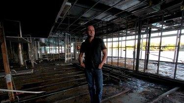 Drift owner David Moore surveys his devasted restaurant shortly after January's flood.