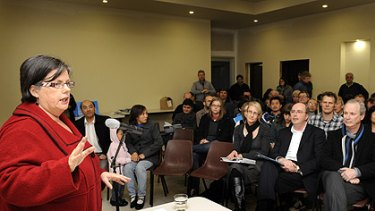 Greens MP Colleen Hartland speaks to Seddon and Footscray residents at the Regional Rail Link community meeting yesterday.