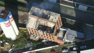 The smouldering remains of the Albion flour mill. Photo: Penny Dahl/Australian Traffic Network.