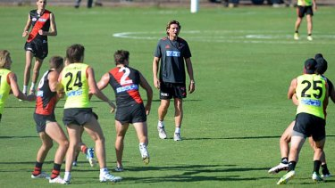 Business as usual … Essendon train on Friday.