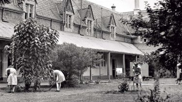 Girls work in the grounds of Parramatta Girls Home in the 1960s.