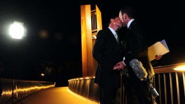 Alan Wright, left, and Joel Player celebrate becoming Australia's first same-sex married couple, at 12.01am on December 7 in Canberra.