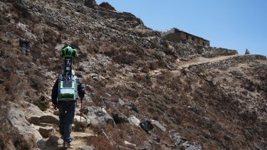 A member of the Google Street View project walks with the camera used to capture project footage through Nepal's Khumbu region.