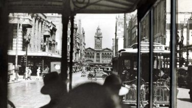A tram approaches Flinders Street Station as another heads for Brunswick.