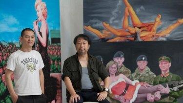 Chinese-Australian artists Guo Jian (left) and Shen Jiawei with Guo's work in Guo's Beijing studio.