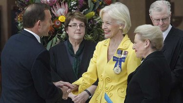 Governor-General Quentin Bryce shakes the hand of Prime Minister Tony Abbott as Speaker Brownwyn Bishop watches on.
