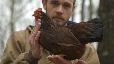 Brian Caraker believes in singing to his chickens.