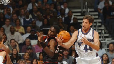 Lengthy career: Christian Laettner fights for the ball for the Washington Wizards against the Philadelphia 76ers in 2001.