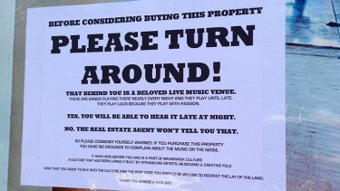 A photograph, posted on Twitter by Marieke Hardy, of a notice taped to a 'for sale' sign on a house near the Retreat Hotel in Brunswick.