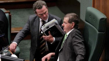 Hard talk ... the manager of opposition business Christopher Pyne has a word to the new Speaker, Peter Slipper.