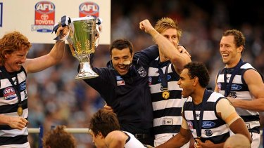 Whooping it up: Geelong players enjoy their big moment after Saturday's grand final win.