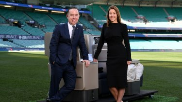 Alan Joyce and Olivia Wirth talk frequent flyer points at Sydney Cricket Ground in June.