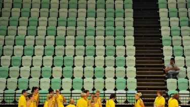 The Australian netball team warms up before their clash with Samoa in front of a near-empty stand.