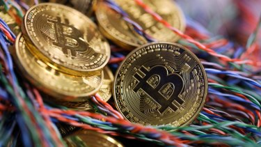 Bitcoin has surged above $US5000, concerning regulators and financial watchers.
