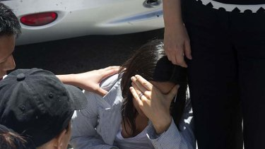 Shock ... a woman is comforted in the streets of Mexico City.