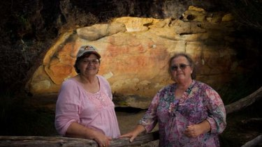 """It's our health, it's our wealth"" ... Anita Selwyn and Barbara Grew in front of a cave with Aboriginal hand stencils at Peats Ridge."