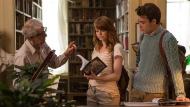 Director Woody Allen on set with Emma Stone and Jamie Blackley.