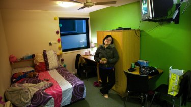 Chef Josephine Lee, 37, in her 'micro apartment' in Flinders Street. She pays $300 a week for 11.2 square metres of living space.