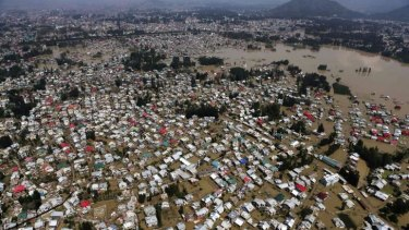 This aerial photo shows  buildings partially submerged in Srinagar, Indian-controlled Kashmir. More than 440 people have been killed in India and Pakistan due to flooding.