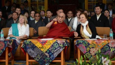 The Dalai Lama (centre) shares a moment with Iranian Nobel Peace laureate Shirin Ebadi (right) as fellow laureate Jody Williams looks on.
