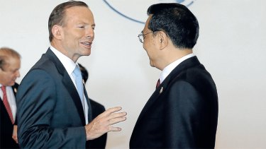 Tony Abbott greets Chinese Premier Li Keqiang at the Boao business forum. <i>Photo: Alex Ellinghausen</i>