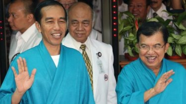Joko Widodo (left) with his running mate Jusuf Kalla.